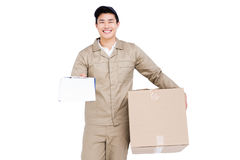 Delivery man holding cardboard box Royalty Free Stock Image