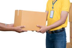 Delivery man holding  cardboard boxes. Delivery asian man. Happy young courier holding  box and smiling on white background Stock Photo