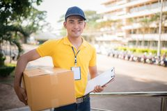 Delivery man holding  cardboard boxes. Transportation Concept Royalty Free Stock Images