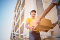 Delivery man holding  cardboard boxes Stock Photos