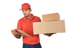 Delivery man holding carton box checking list in uniform Royalty Free Stock Photo