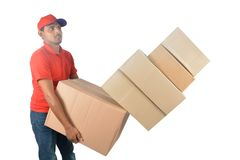 Delivery man holding carton boxes in uniform Stock Photo