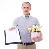 Delivery man holding clipboard and bunch of flowers isolated on Stock Images