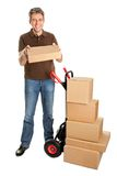 Delivery man holding the package Royalty Free Stock Photography