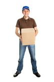 Delivery man holding package box Stock Images