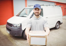Delivery man holding package Royalty Free Stock Photo