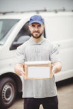 Delivery man holding package Royalty Free Stock Image