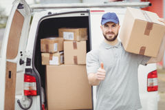 Delivery man holding package Stock Image