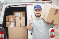 Delivery man holding package Stock Images