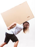 Delivery man holding a paper box. Royalty Free Stock Image