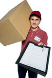 Delivery man holding a paper box and requests to subscribe Stock Image