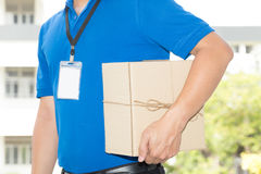 Delivery man holding a parcel box. Delivery service concept. Sending Stock Photography
