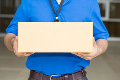 Delivery man holding a parcel box Royalty Free Stock Photo