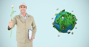 Delivery man holding rose by low poly earth Royalty Free Stock Photos