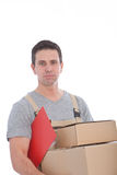 Delivery Man Holding Stack of Cardboard Boxes Stock Photos