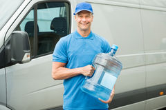 Delivery Man Holding Water Bottle Stock Image