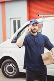 Delivery man making a phone call Stock Images