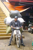 Delivery man motorbike stock photography