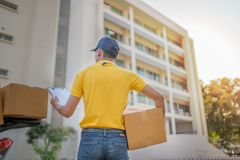 Delivery man and motorcycle Royalty Free Stock Photography