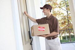 Delivery Man with Package Royalty Free Stock Photo