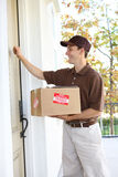 Delivery Man with Package Stock Images