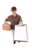 Delivery Man with Package. A handsome young delivery man delivering a package stock photo