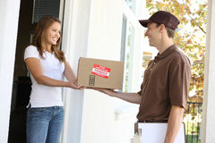 Delivery Man with Package. A handsome young delivery man delivering a package Royalty Free Stock Image
