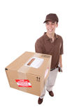 Delivery Man with Package. A handsome young delivery man delivering a package stock photography
