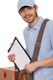 Delivery man with package and clipboard Royalty Free Stock Photography