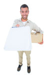 Delivery man with package giving clipboard for signature Stock Photo