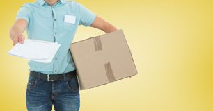 Delivery man with package giving clipboard for signature Royalty Free Stock Photography
