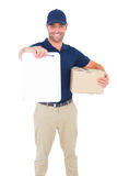 Delivery man with package giving clipboard for signature Stock Image