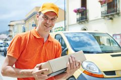 Delivery man with package outdoors Stock Image
