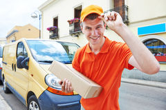 Delivery man with package outdoors Stock Photography