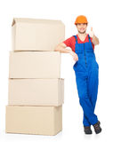 Delivery man with paper boxes and thumbs up sign Royalty Free Stock Photography