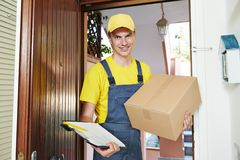 Delivery man with parcel box indoors Royalty Free Stock Photo