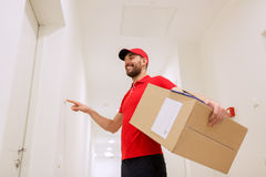 Delivery man with parcel box ringing doorbell Stock Image
