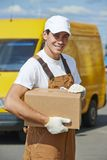 Delivery man with parcel box Royalty Free Stock Images