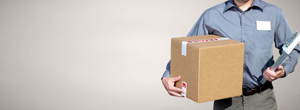 Delivery man with a parcel. Royalty Free Stock Photos