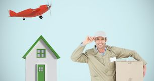 Delivery man with parcel by house and airplane Royalty Free Stock Photos