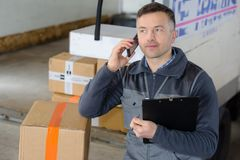 Delivery man with parcel near cargo truck shipping service stock photos