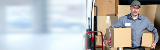 Delivery man with a parcel. Stock Images