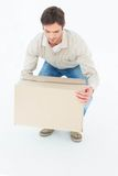 Delivery man picking cardboard box Royalty Free Stock Photo