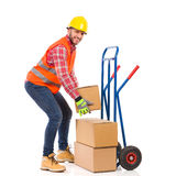 Delivery man picking up a package Royalty Free Stock Photos