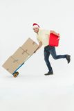 Delivery man pushing trolley of boxes during Christmas Royalty Free Stock Photography