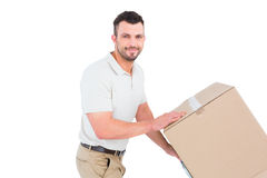 Delivery man pushing trolley of boxes Royalty Free Stock Photo