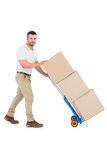 Delivery man pushing trolley of boxes Stock Photos