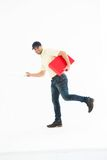 Delivery man with red box running on white background Stock Images