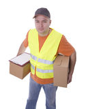 Delivery man in reflective waistcoat keeping boxes Royalty Free Stock Photo