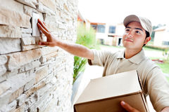 Delivery man ringing doorbell Stock Images
